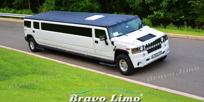 White hummer limo 22 pass.